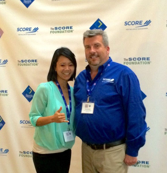 Niki receives her $1,000 Sam's Club Gift Card from David Bobbit, President of The SCORE Foundation!